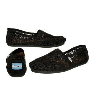 Toms black lace flats.